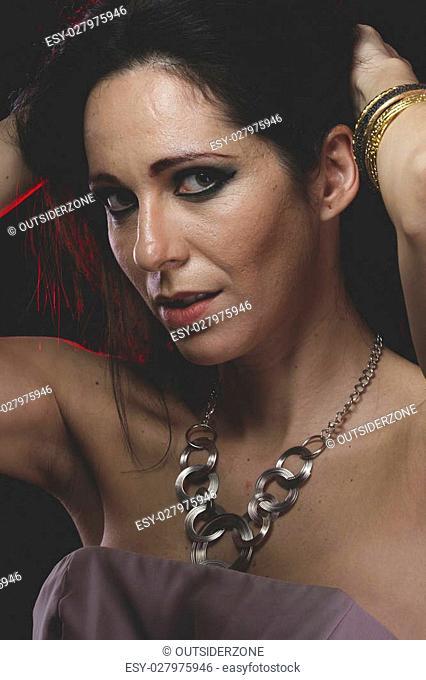 Sensuality, woman with Venetian mask metal, sad and pensive