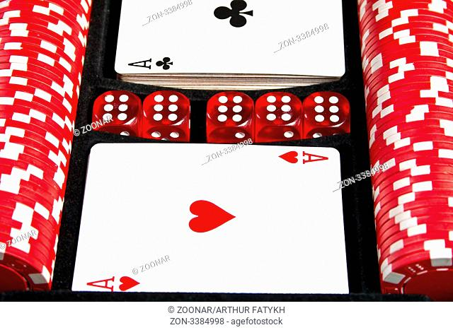 Set of chips, dices and cards for the poker in suitcase