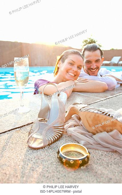 couple smiling in pool,dressed