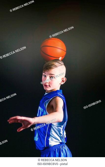 Boy about to throw basketball