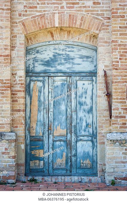 Europe, Italy, Marche / Marches, Offida, weather-beaten side door church Santa Maria della Rocca