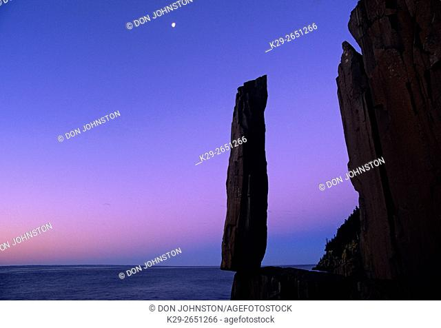 Moon setting over Balancing Rock before dawn, Tiverton, Scotia, Canada