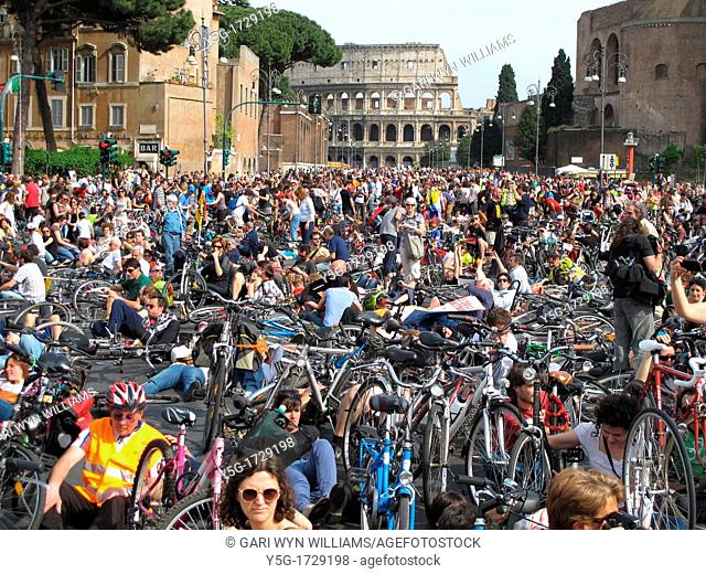 Salvaiciclisti bike protest for improved safety for riders on Via dei Fori Imperiali Street by Colosseum in Rome, Italy
