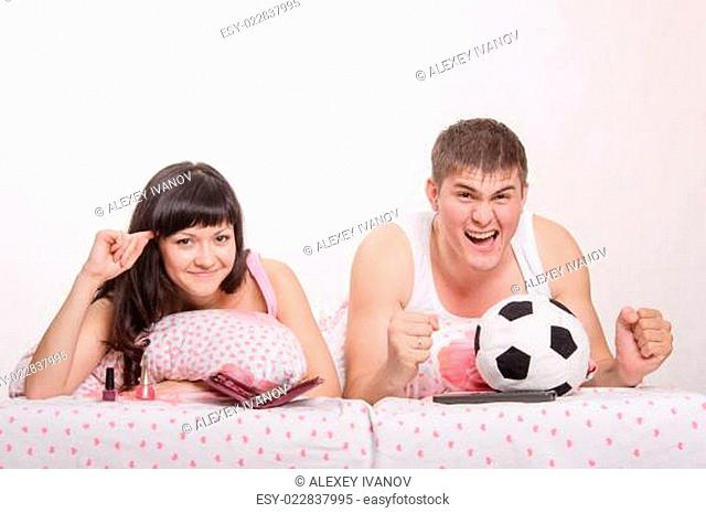 Man watches football fanatic wife goes crazy already