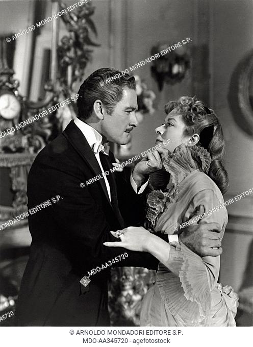 Greer Garson and Errol Flynn in 'That Forsyte Woman'. British actress Greer Garson and Australian actor Errol Flynn in a scene of passion in 'That Forsyte...