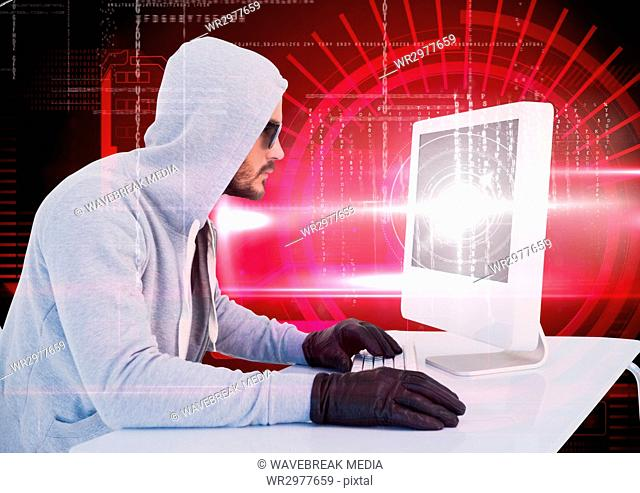 Hacker with sunglasses using a laptop in front of digital red background