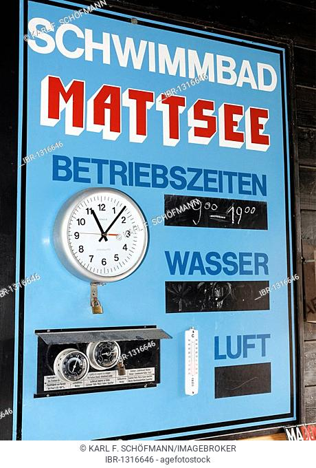 Historic lido from 1927, sign with operating times and water and air temperatures, with clock, Mattsee, Flachgau, Salzburger Land region, Salzburg, Austria