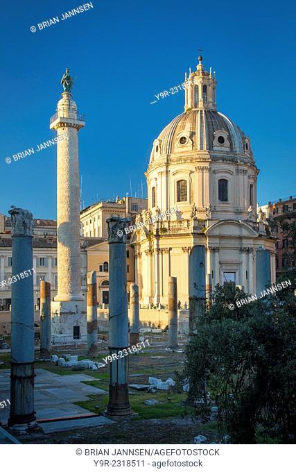 Trajan's Column and ruins of Trajan's Forum with Santissimo Nome di Maria church beyond, Rome Lazio Italy