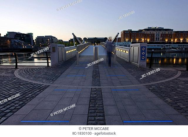 Sean O'Casey Bridge, River Liffey, Dublin City, Ireland, Person crossing city pedestrian bridge over river