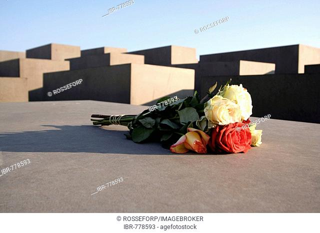 Bunch of roses on one of the concrete blocks of the Holocaust Memorial in Berlin, Germany, Europe