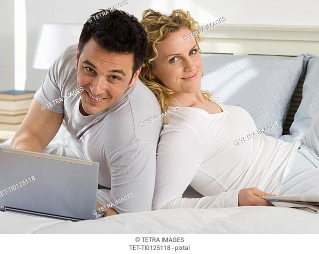 Portrait of couple on bed