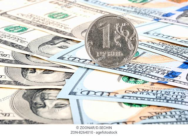 Coin Russian ruble and dollar bills