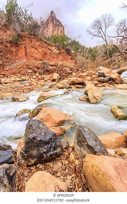Cascading water falls on the Virgin River at the base of the Court of the Patriarchs at Zion National Park