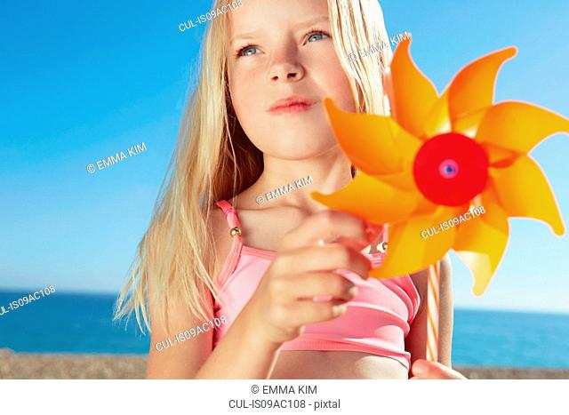 Girl holding toy windmill