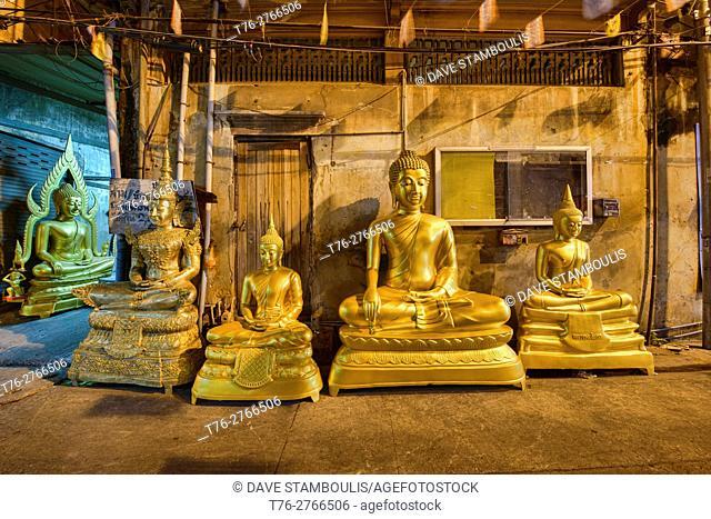 Street of Buddha statues in Bangkok, Thailand