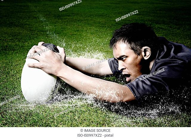 Rugby player on wet field