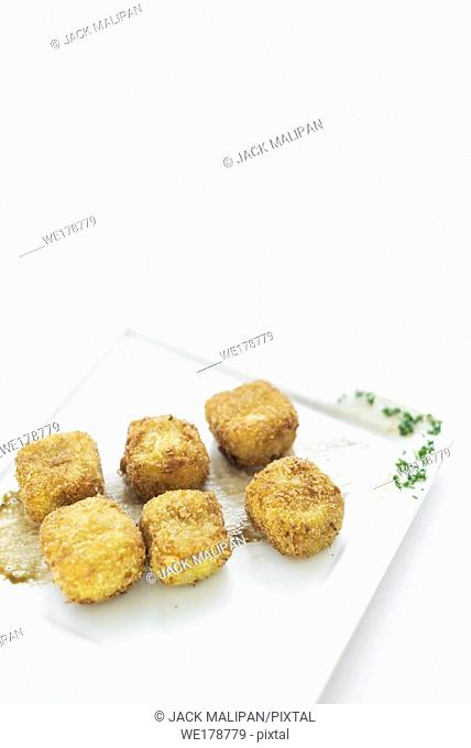 fried mashed potato square croquettes simple vegetarian side dish on white plate