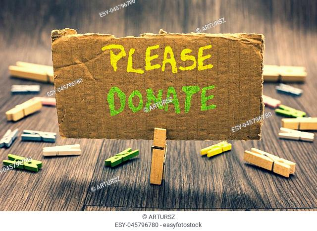 Writing note showing Please Donate. Business photo showcasing Supply Furnish Hand out Contribute Grant Aid to Charity Clothespin holding paperboard important...