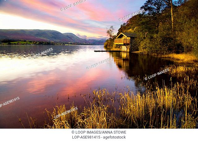 Early morning light falls on a boathouse near Pooley Bridge on the shores of Ullswater