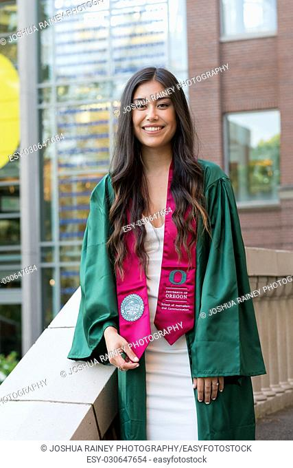 EUGENE, OR - MAY 22, 2017: Female college grad in the Lillis business plaza for graduation photos on campus at the University of Oregon in Eugene