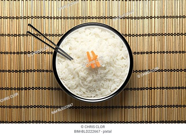 Chopsticks in bowl of white rice