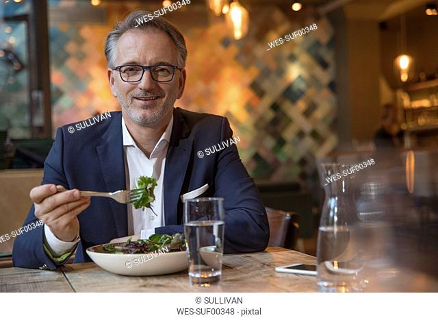 Portrait of businessman having lunch in a restaurant