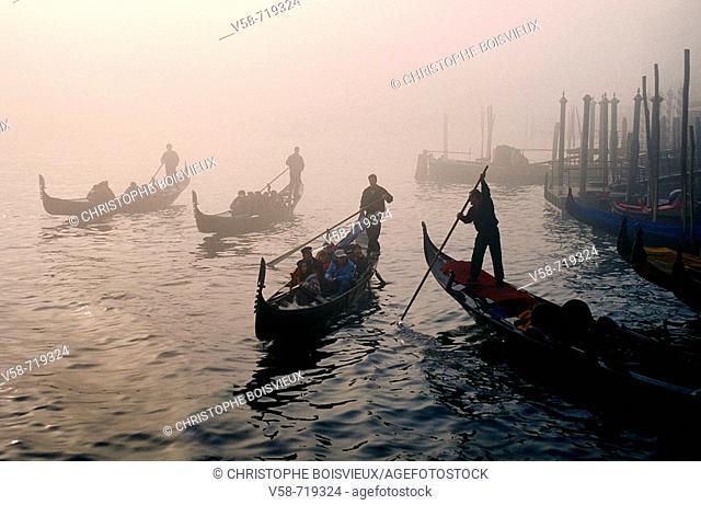 Gondolas in the fog. Grand Canal. Venice. Italy