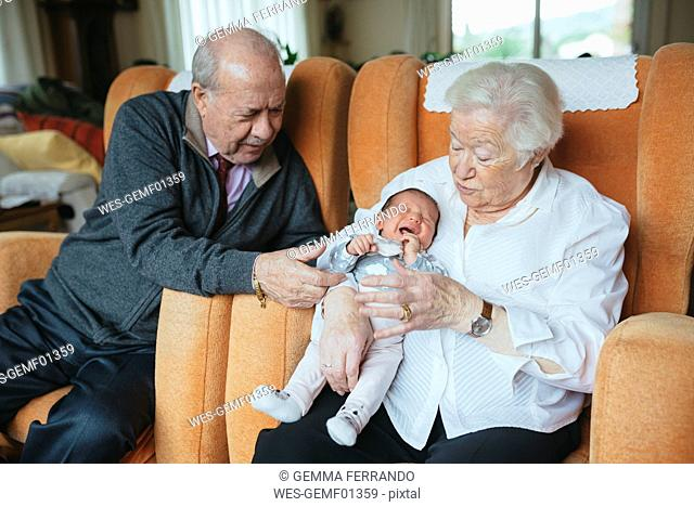 Great grandparents taking care of great granddaughter at home