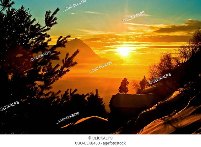 Overlooking the sunset from Pra Such in the Rhaetian Alps, Lombardy, Italy, Europe