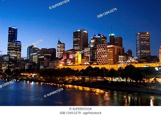 Skyscrapers in a city lit up at night, Yarra River, Melbourne, Australia