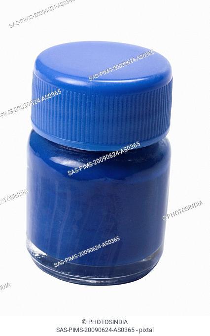 Close-up of a blue watercolor bottle
