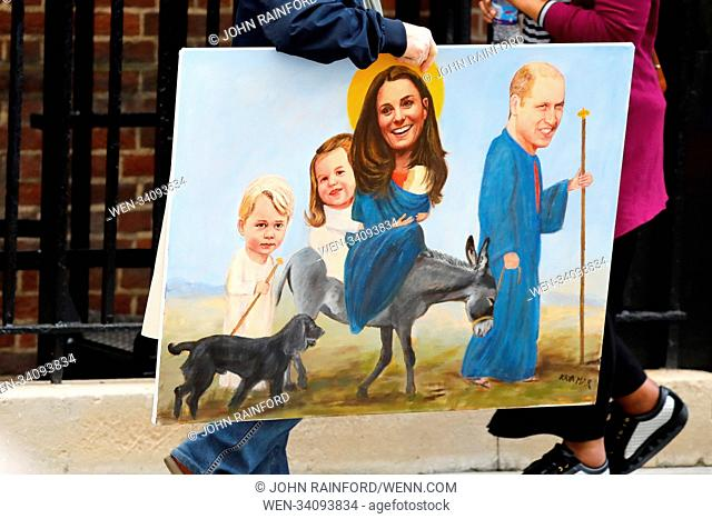 Royal fans gather outside the Lindo Wing at St Mary's Hospital in Paddington, London, where the Duchess of Cambridge has been admitted in the early stages of...