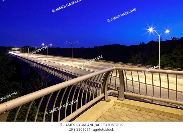 An viewpoint that looks over the Smith-Triller Viaduct that crosses 16 Mile Creek along Dundas Street at dusk. Oakville, Ontario, Canada
