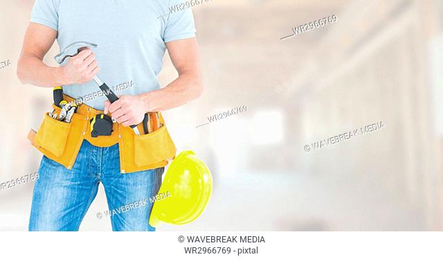 Carpenter with tools on building site