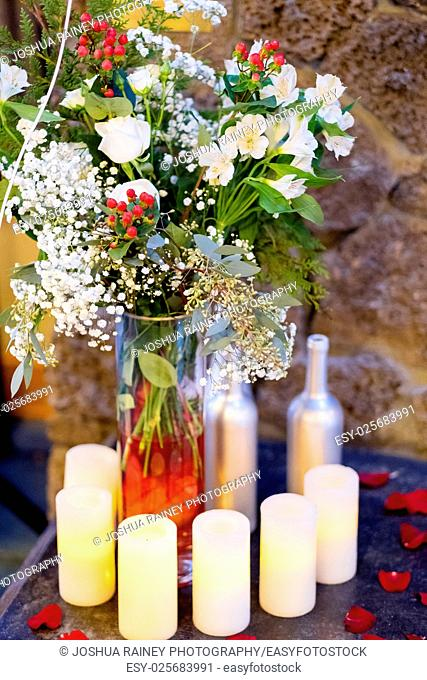 Wedding decor of flameless candles and white flowers at a ceremony in Bend Oregon during the winter