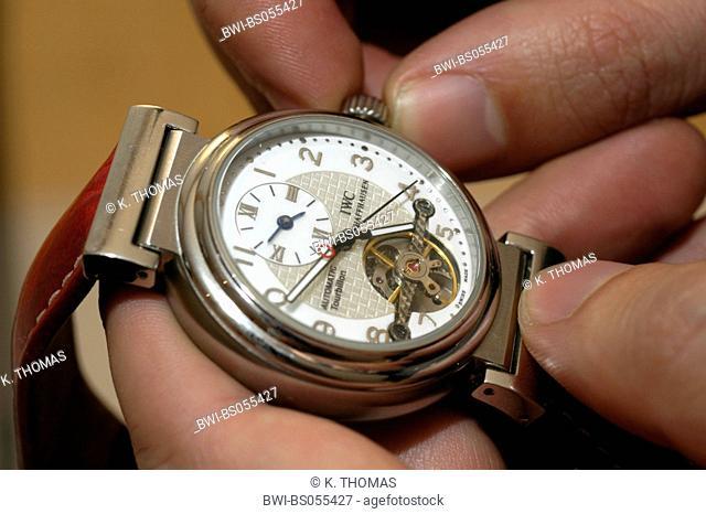 winding up a watch, clock face