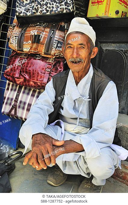 The man selling bags