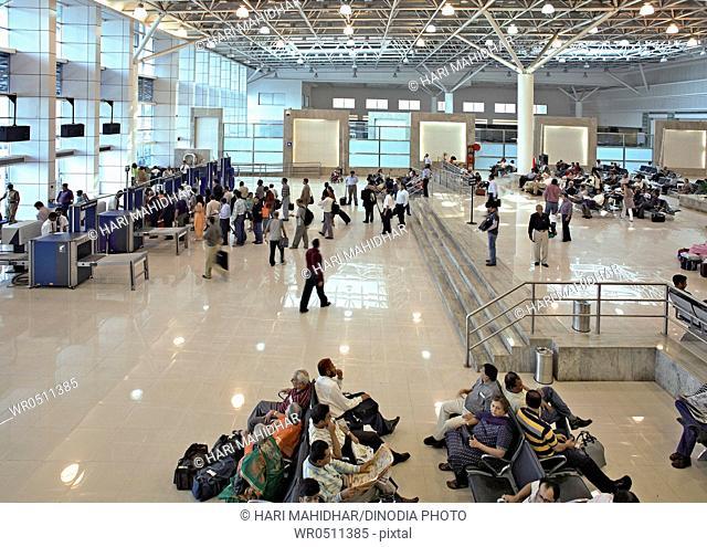 Passengers in lobby of chhatrapati shivaji international airport , Santacruz , Bombay Mumbai , Maharashtra , India