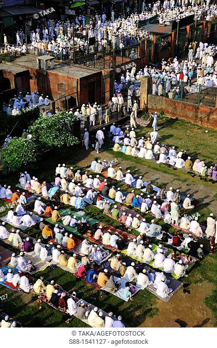 Early in the morning, the end of the day of Ramadan, Jama Masjid Mosque in Old Delhi  Inside of the Mosque was packed  There were many people praying outside