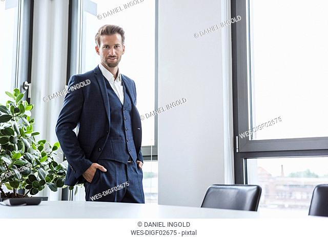 Portrait of businessman standing in his office