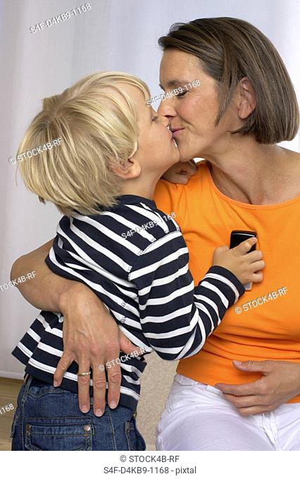 Mother and son 4-5 Years kissing