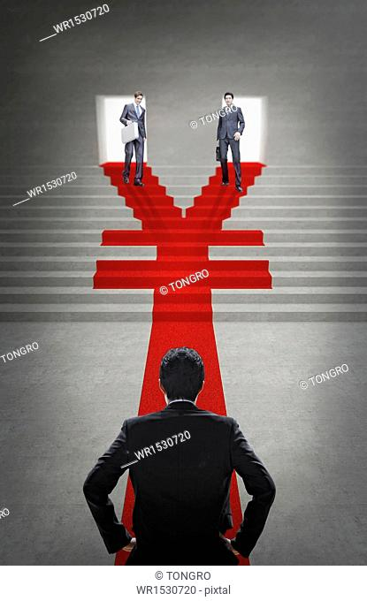 two business men walking down a Yuan shape staircase