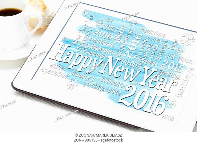 Happy New Year 2016 - word cloud on a digital tablet with a cup of coffee