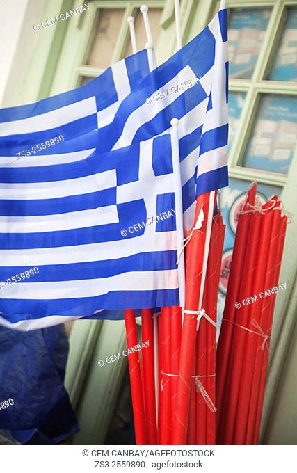 Greek flags and candles in a shop, Hora, Tinos, Cyclades Islands, Greek Islands, Greece, Europe