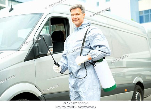 Happy Worker With Pesticide Sprayer Standing In Front Van