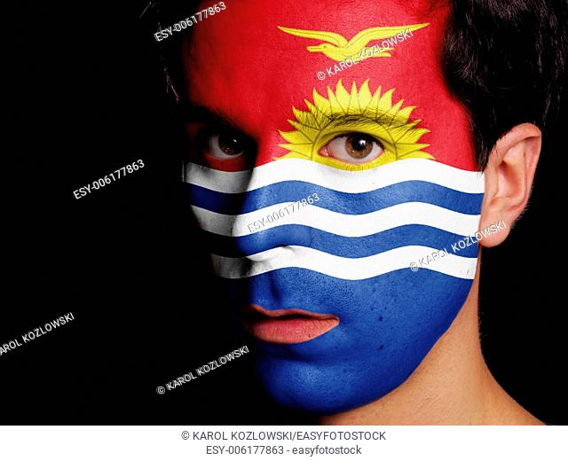 Flag of Kiribati Painted on a Face of a Young Man