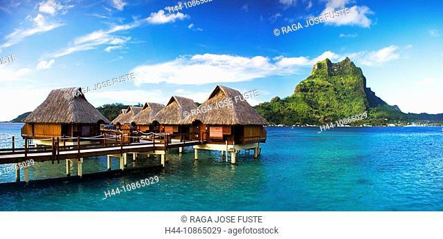 Tahiti, Society Islands, Bora Bora Island, Huts and mount Otemanu