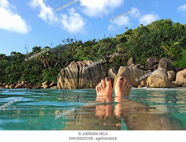 Womens feet, split level, Anse Lazio, Baie Sainte Anne district, Island of Praslin, Seychelles, Indian Ocean, Africa