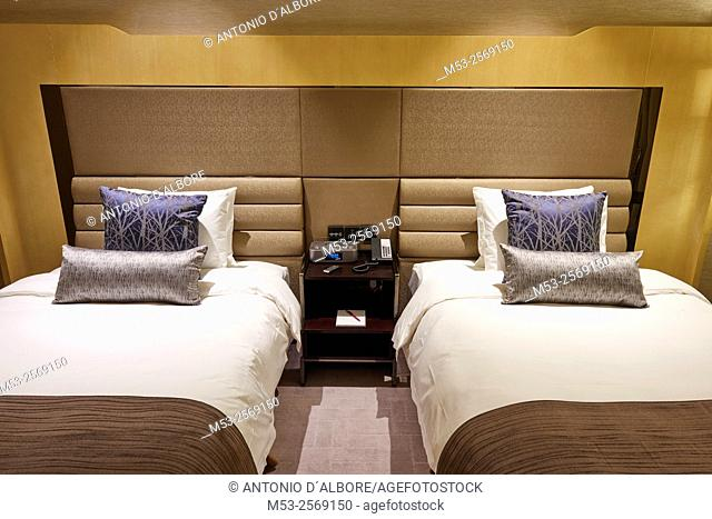 Twin beds in a luxury hotel room