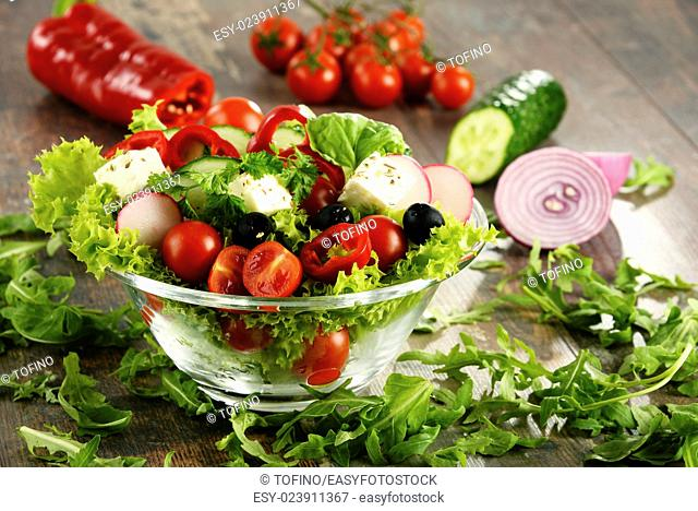 Vegetable salad bowl on kitchen table. Balanced diet